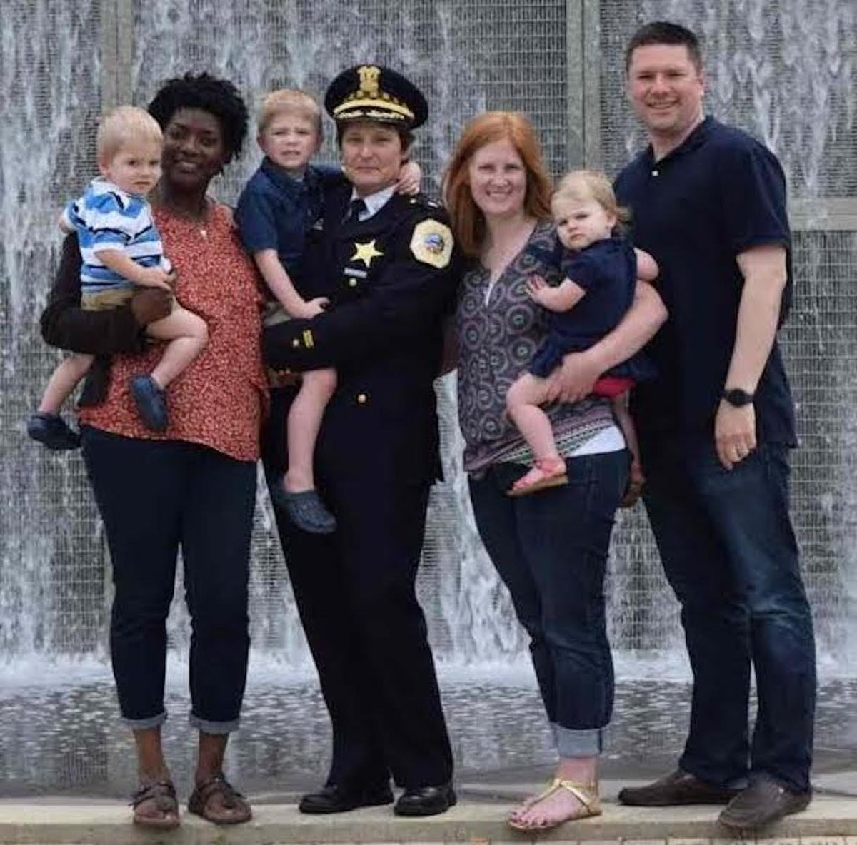 Johanne M. Kenol and her wife Nancy Lipman (center) with Lipman's son Christopher and wife Diana and their three children.