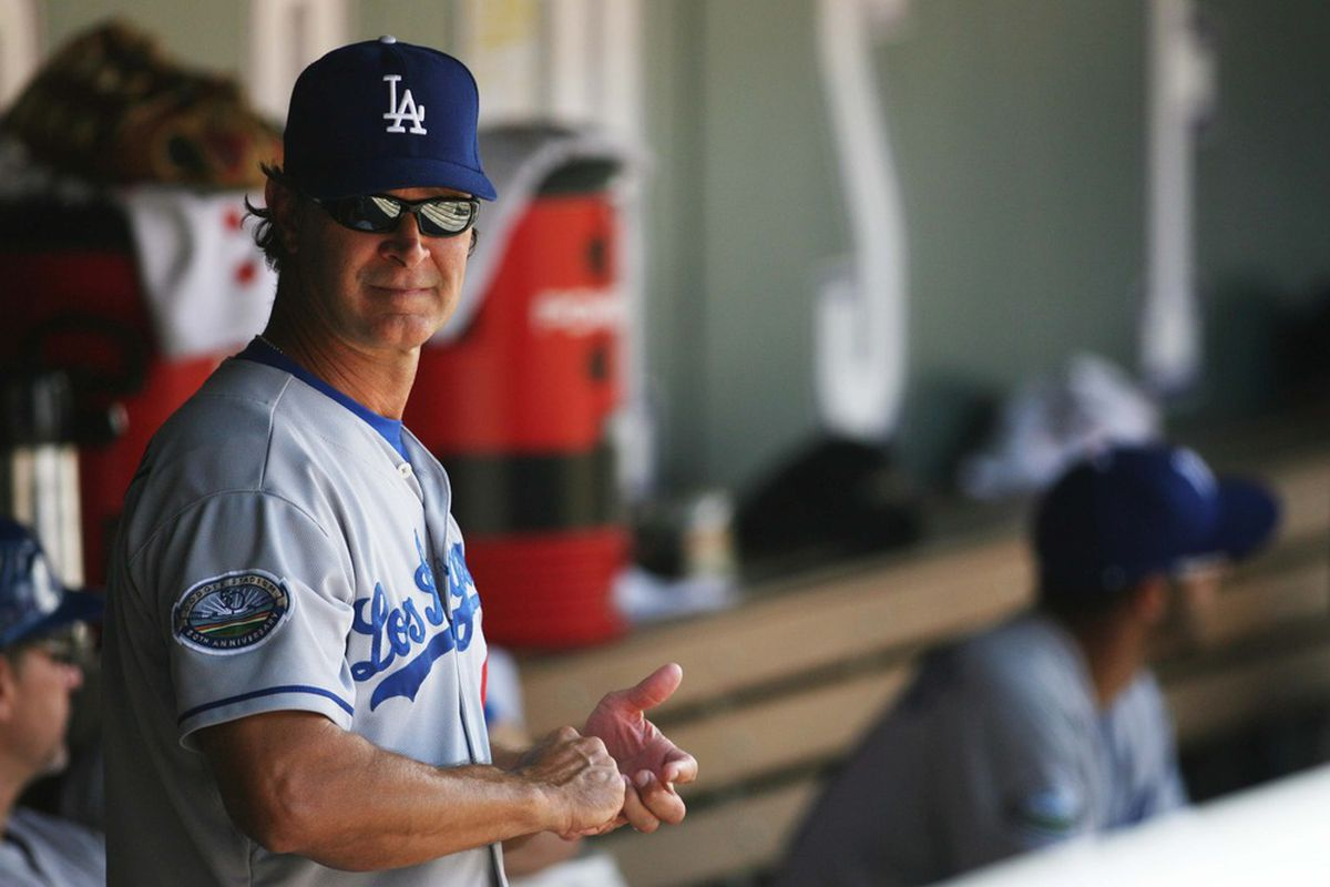 June 3, 2012; Denver, CO, USA; Los Angeles Dodgers manager Don Mattingly in the dugout before  the first inning against the Colorado Rockies at Coors Field.  Mandatory Credit: Chris Humphreys-US PRESSWIRE