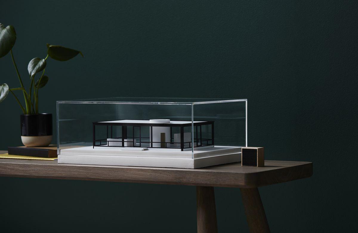 Glass House replica under acrylic box.