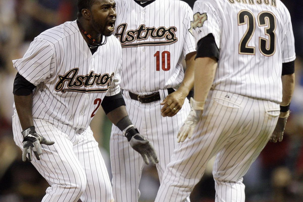 HOUSTON -  Bill Hall celebrates with Chris Johnson and first base coach Bobby Meacham after the Astros beat the Cardinals 6-5 at Minute Maid Park on April 26. (Photo by Bob Levey/Getty Images)