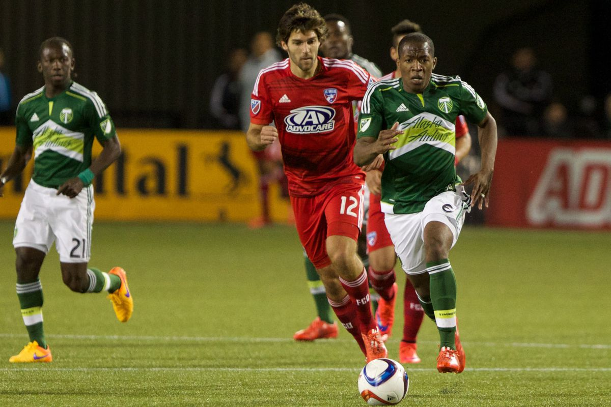 Darlington Nagbe dribbles upfield as he is chased by a FC Dallas defender.