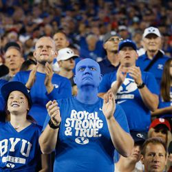 Fans react as BYU and Utah compete in an NCAA college football gameat LaVell Edwards Stadium in Provo on Saturday, Sept. 11, 2021.