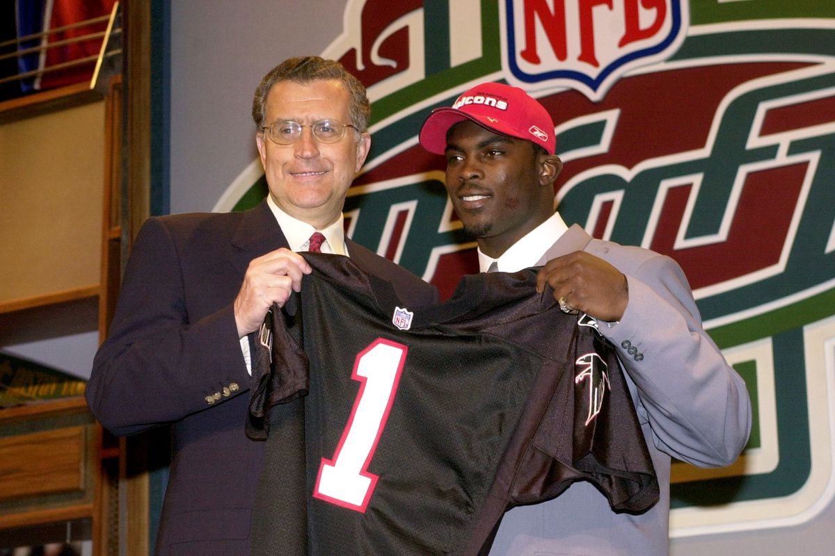 NFL Commissioner Paul Taglibue holds an Atlanta Falcons' jer