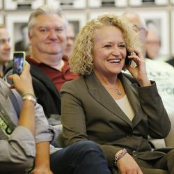 Mayor-elect Jackie Biskupski takes a call from Mayor Ralph Becker prior to the Salt Lake City Council, acting as the city's  board of canvassers, certifying final election results on Tuesday, Nov. 17, 2015, at the City-County Building. Biskupski beat Becker by 1,194 votes — 51.55 percent to 48.45 percent — with more than 38,000 votes cast.