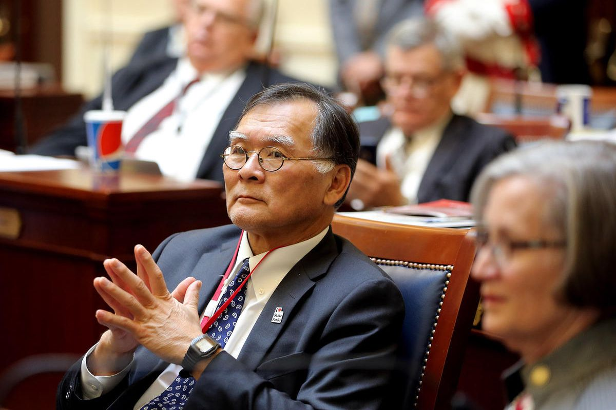 FILE — Senator Brian E. Shiozawa watches as members of the Utah Society Sons of the American Revolution present the colors in the Senate at the state Capitol Tuesday, Feb. 23, 2016. Shiozawa sponsored a bill to make assaulting a health care professional i