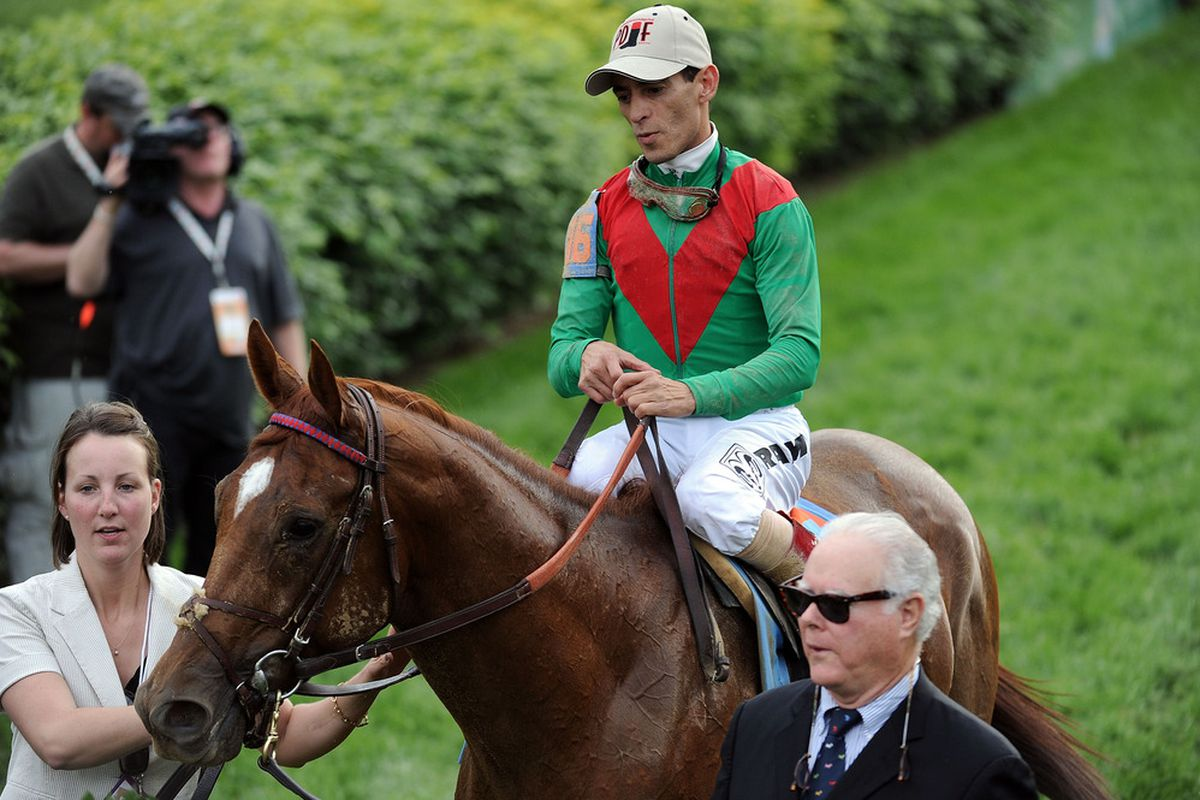 LOUISVILLE, KY - MAY 07:  Jockey John Valazquez, riding Animal Kingdom #16, celebrates winning the 137th Kentucky Derby at Churchill Downs with owner Barry Irwin on May 7, 2011 in Louisville, Kentucky.  (Photo by Harry How/Getty Images)