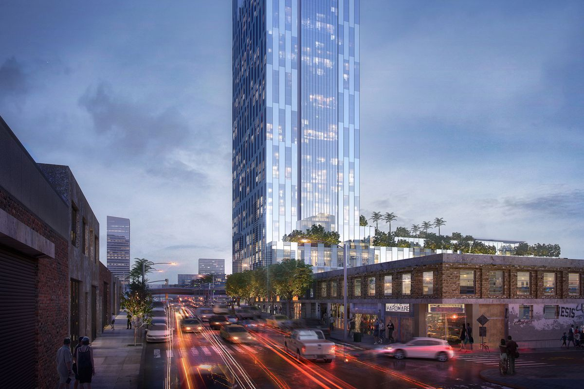 A rendering of a glassy 37-story hotel, seen at night, rising above a busy street and surrounded by lower-rise buildings.