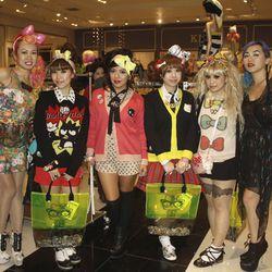 Hello Kitty fans, posing.