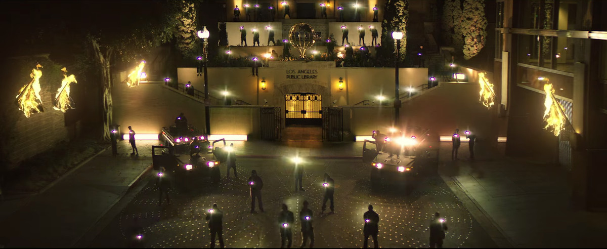 People walking around the Los Angeles Public Library with flashlights