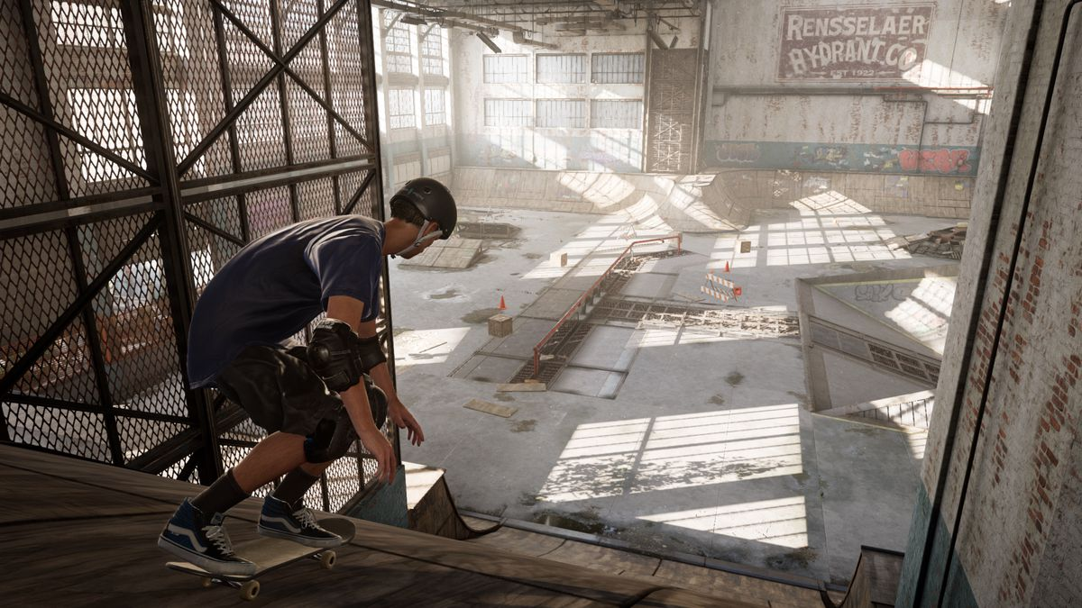 Tony Hawk stands on a ramp in a warehouse from Tony Hawk's Pro Skater 1 and 2