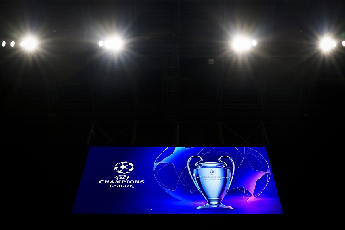 A scoreboard displays the logo and the trophy of UEFA...