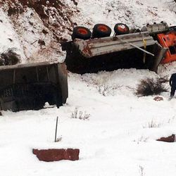 A snowplow crash in Spanish Fork Canyon is pictured on Thursday, Jan. 12, 2017. Terry Jacobson, a 23-year veteran of the Utah Department of Transportation's snow removal services, was injured in the crash.