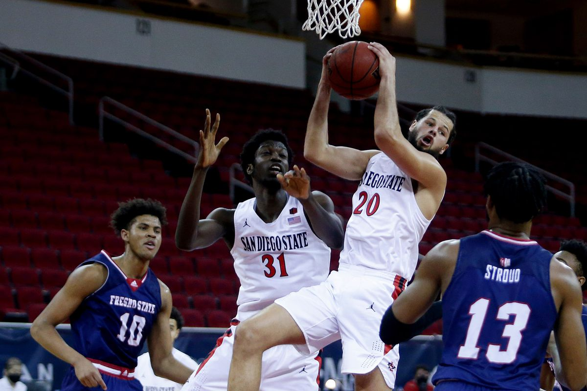 San Diego State Aztecs guard Jordan Schakel rebounds the ball against Fresno State Bulldogs guard Deon Stroud during the second half at Save Mart Center.