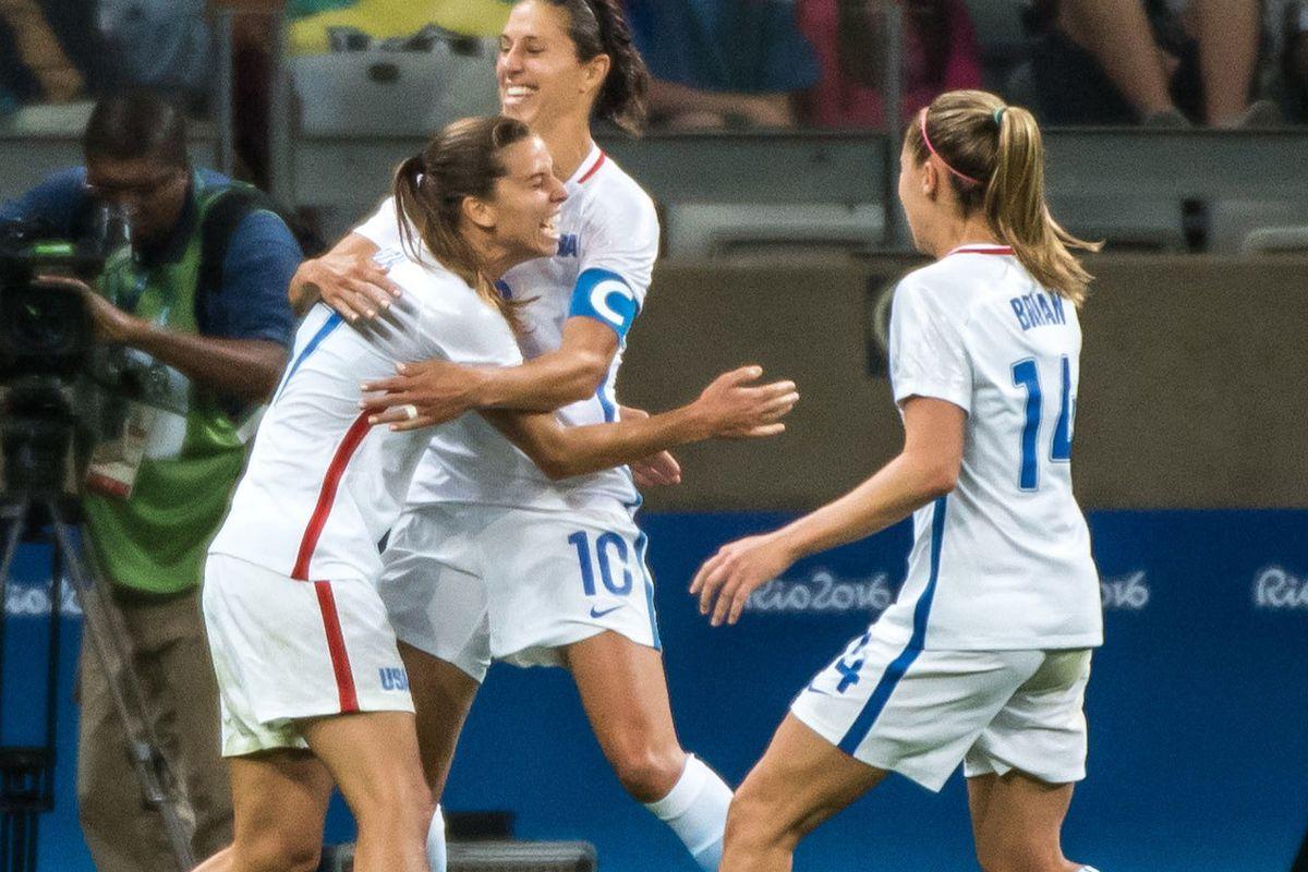 Tobin Heath, Carli Lloyd, and Morgan Brian celebrate in the U.S. Women's National Team's win against France. (GettyImages)