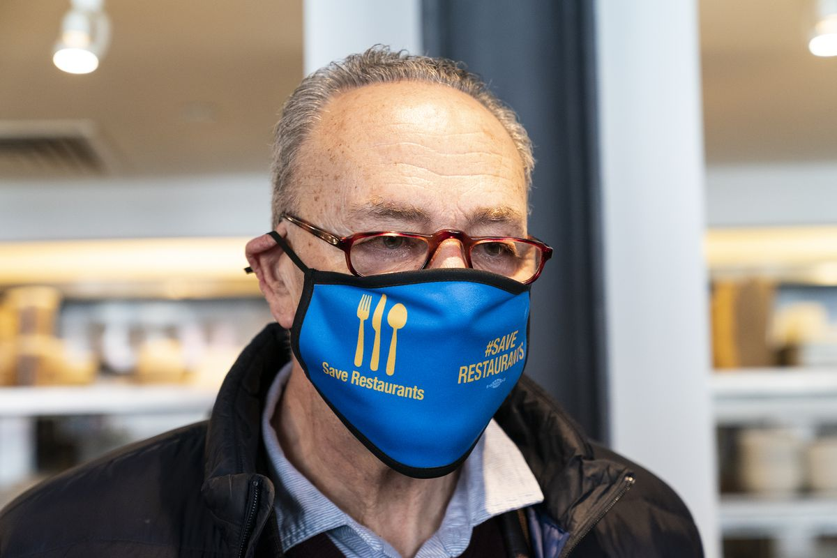 """Senate Majority Leader Chuck Schumer wearing a mask with """"..."""