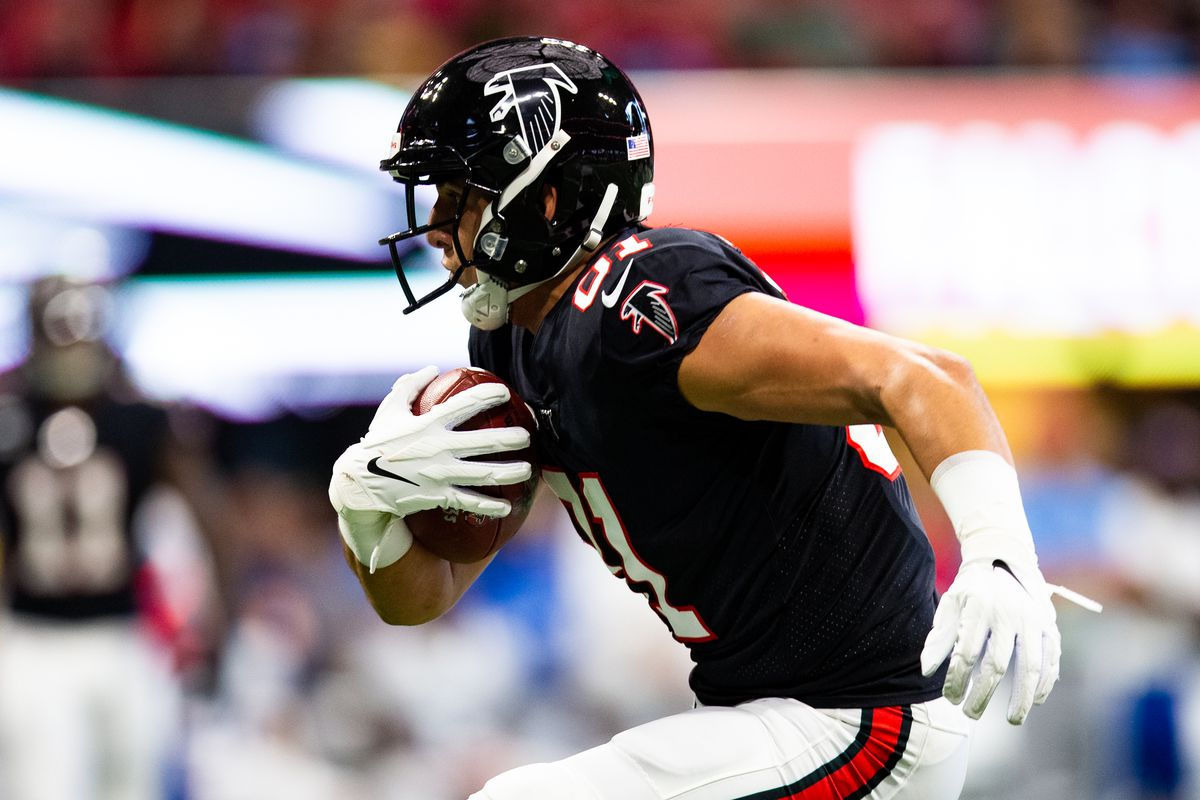 Austin Hooper of the Atlanta Falcons runs with the ball during a game against the Tennessee Titans at Mercedes-Benz Stadium on September 29, 2019 in Atlanta, Georgia.