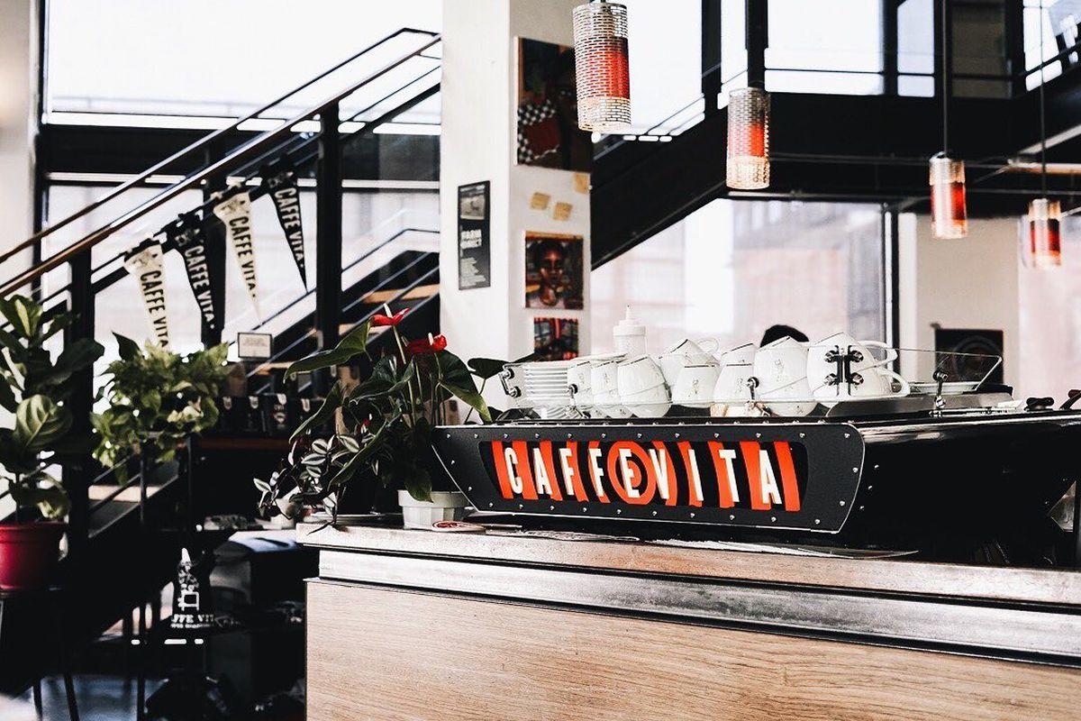 A coffee machine with Caffé Vita's logo on it.