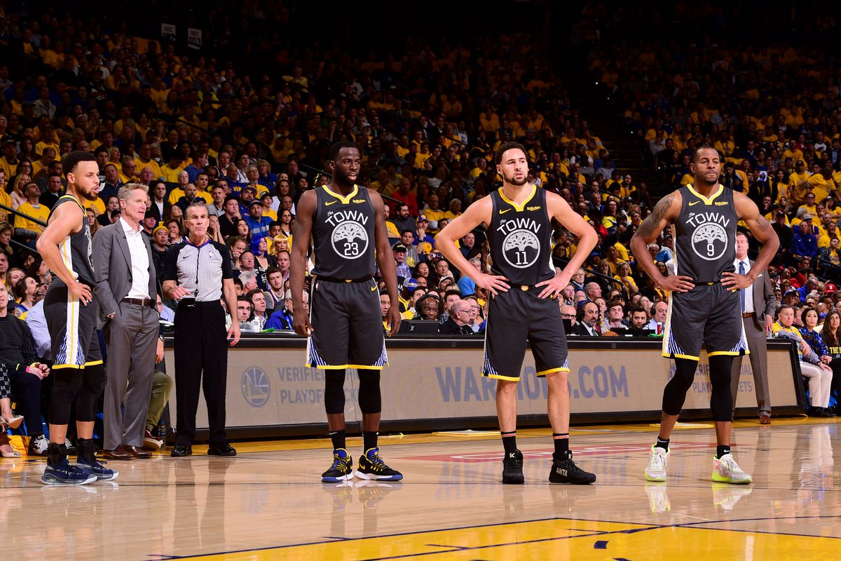 Stephen Curry, Draymond Green, Klay Thompson, and Andre Iguodala look on during Game Two of the 2019 Western Conference Finals of the NBA Playoffs at the ORACLE Arena on May 16, 2019 in Oakland, California.