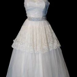 """Looking for a gown with some history? Wicker Park's <a href=""""http://www.silvermoonvintage.com/shopintro.htm"""">Silver Moon</a> [1721 West North Avenue] has the city's largest collection of vintage bridal gowns. Styles could include flapper-style looks from"""