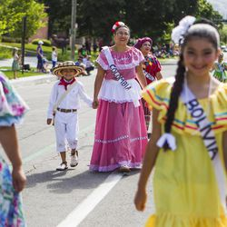 Participants representing different Latin American countries walk during the Days of '47 Union Pacific Railroad Youth Parade held Saturday, July 18, 2015, in Salt Lake City.