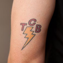 """""""Michael and I share this tattoo of Elvis' band's logo with three other friends from Frederick, but mine's in Maryland colors."""""""