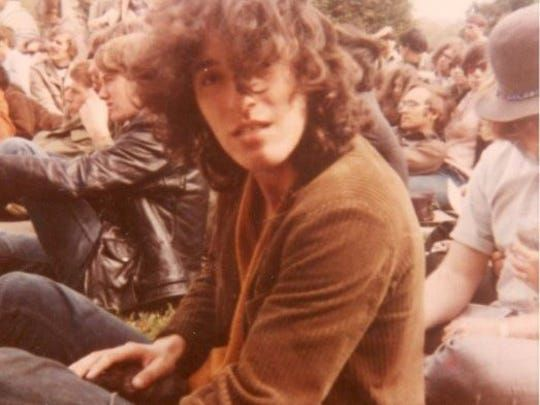 """Bruce Springsteen in the crowd at Monmouth College in New Jersey, watching another band perform in 1969 before his band, """"Child,"""" took the stage."""