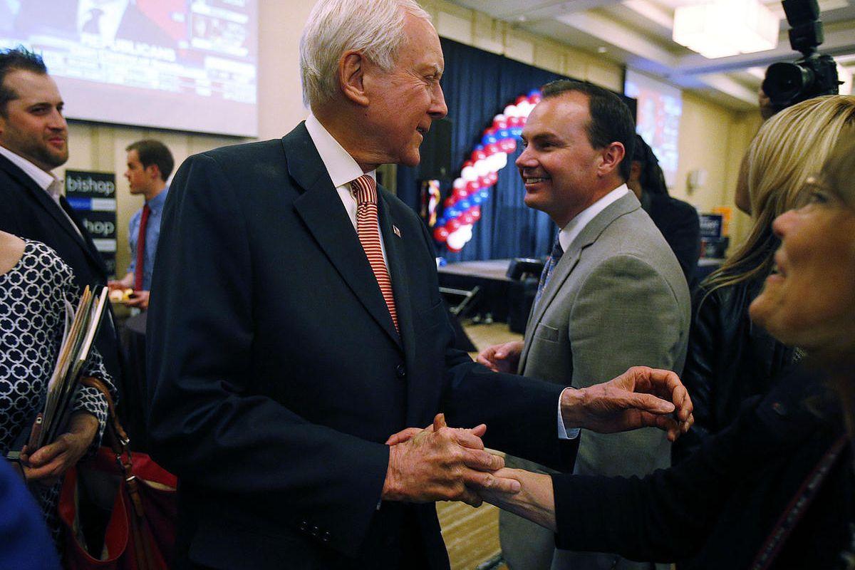 FILE - Sen. Orrin Hatch, R-Utah, and Sen. Mike Lee, R-Utah greet on election night in Salt Lake City, Tuesday, Nov. 4, 2014.