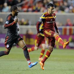 Real Salt Lake midfielder Javier Morales (11) boots the ball past Toronto FC defender Jeremy Hall (25) during a game at Rio Tinto Stadium in Sandy on Saturday, March 29, 2014.