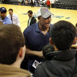 Karl Malone greets fans following the Utah Jazz's scrimmage in Salt Lake City, Saturday, Oct. 5, 2013.