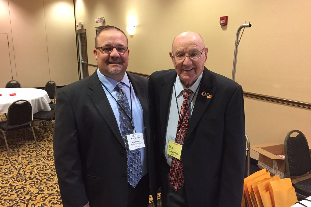 Harold Samorian, right, who died this week at 89, was one of the state's most respected football coaches and wrestling officials over a career that spanned decades. He's shown at a football coaches clinic with Bob Pieper, who broke Samorian's program record for wins as Glenbrook North football coach.
