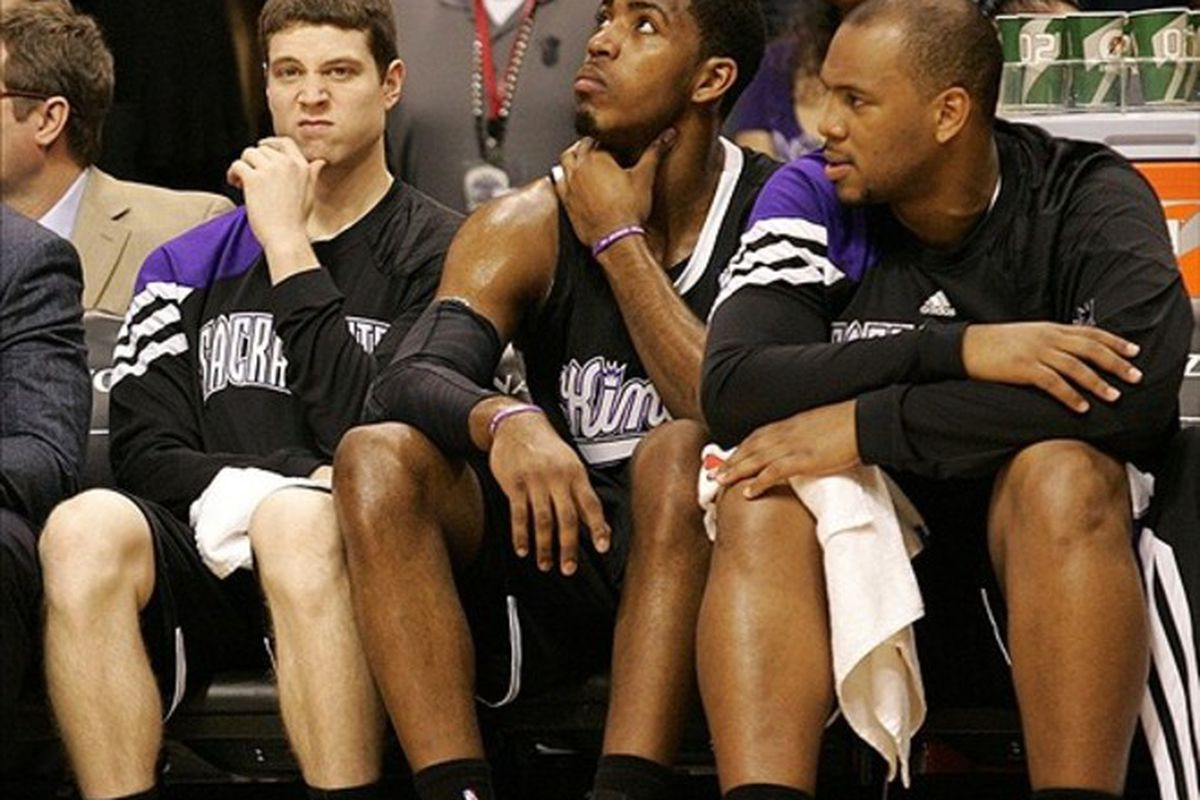 Mar 4, 2012; Phoenix, AZ, USA; Sacramento Kings point guard Jimmer Fredette (left) on the bench during the fourth quarter against the Phoenix Suns at US Airways Center.  Mandatory Credit: Jake Roth-US PRESSWIRE