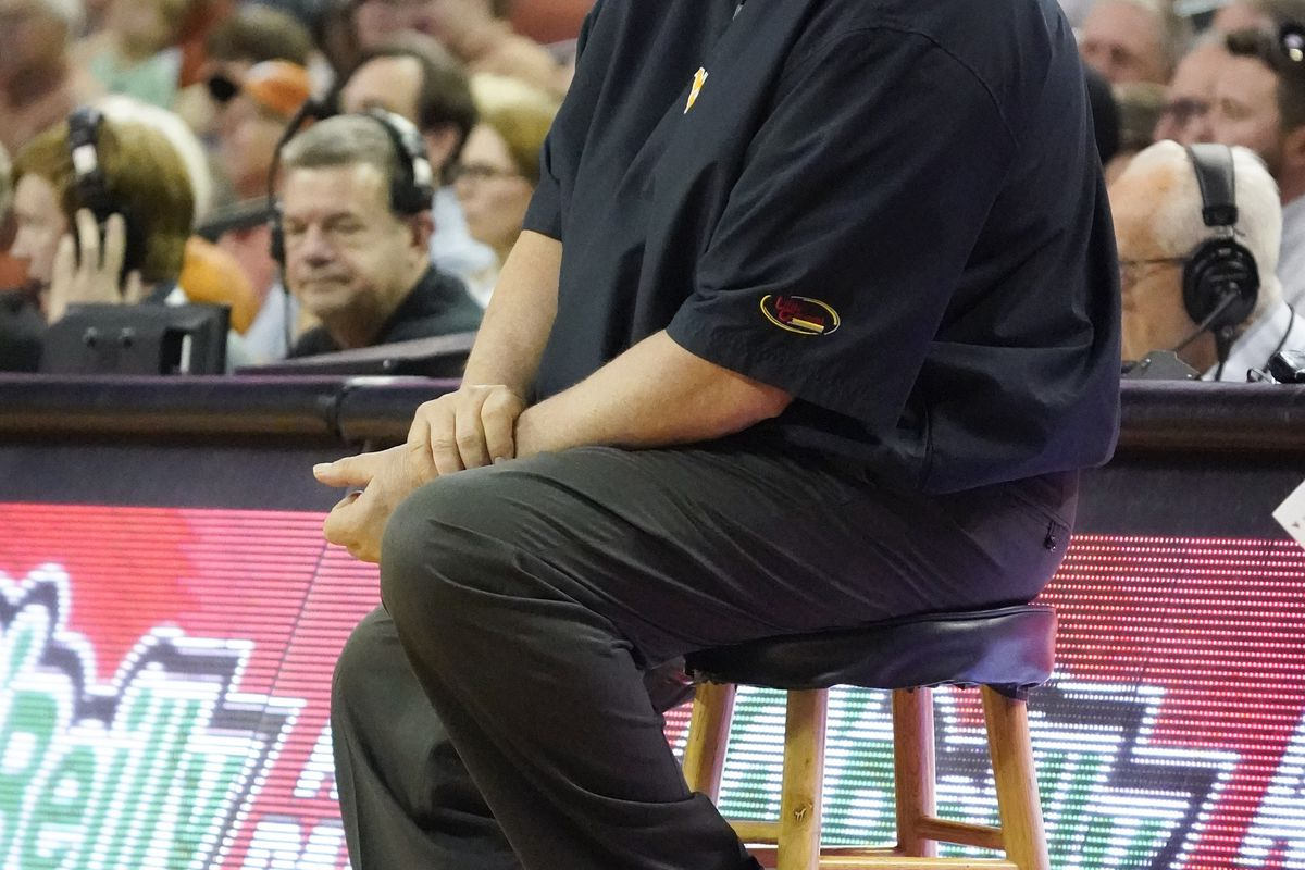 West Virginia Mountaineers head coach Bob Huggins yells to players from a stool in the first half of the game against the Texas Longhorns at Frank C. Erwin Jr. Center.