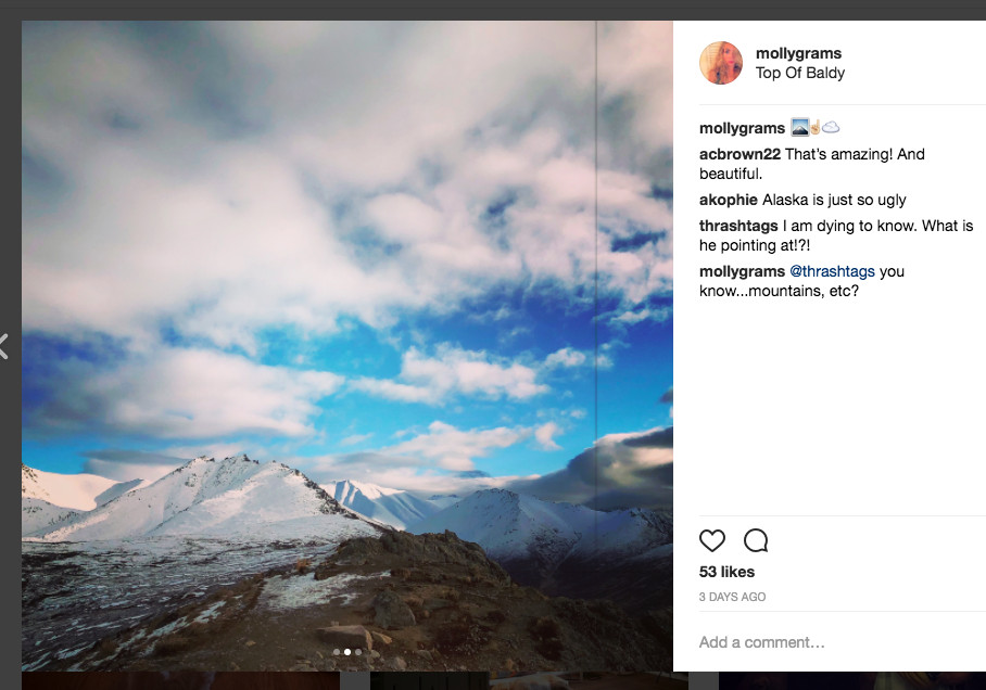 Screenshot of an Instagram post of a mountain with a vertical black line running through the image near the right side