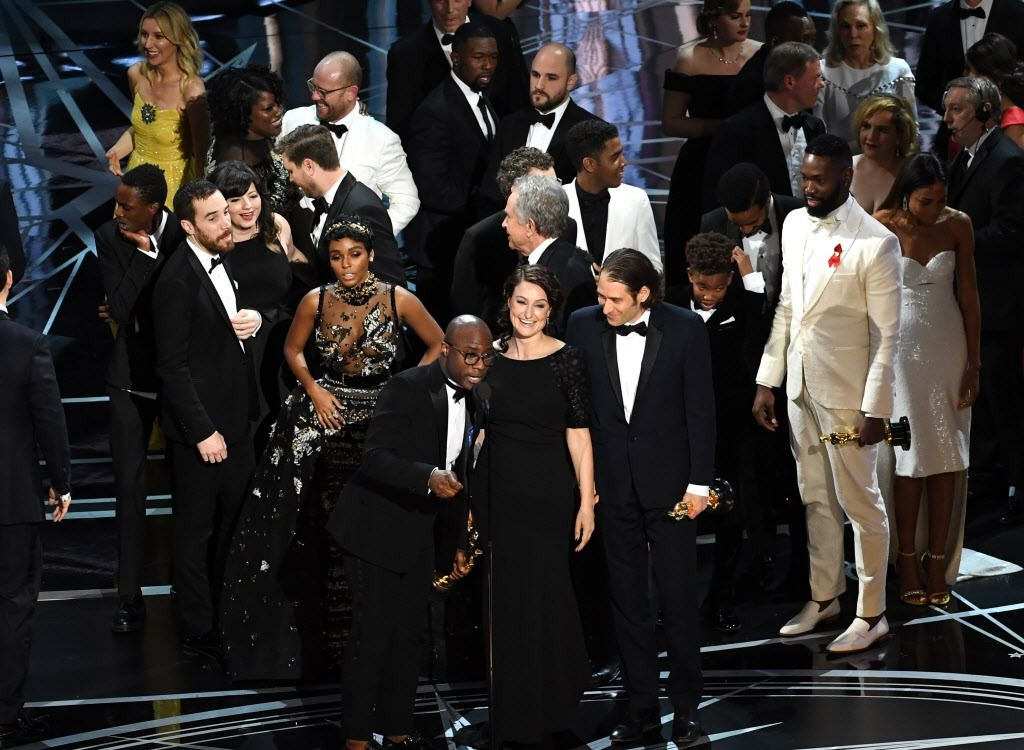 Producer Adele Romanski (center) writer/director Barry Jenkins, producer Jeremy Kleiner and cast/crew members accept Best Picture for 'Moonlight' onstage during the 89th Annual Academy Awards at Hollywood & Highland Center on February 26, 2017 in Holl