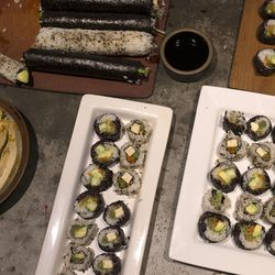 Vegan Chef Molly Aubuchon and her son Sam created vegan maki rolls for dinner and the next day's school lunch in her Kent, Ohio, home.