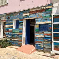 The exterior of this building used by Mediterranean Hope in Lampedusa is made of planks from boats that ferried migrants from Africa to the Italian island.