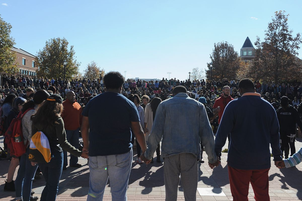 Protestors at the University of Missouri hold a moment of silence during a press event.