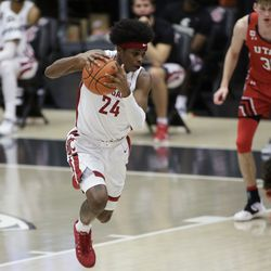 Washington State guard Noah Williams gets control of the ball after a scramble for a rebound following his missed shot during the second half of the team's NCAA college basketball game against Utah in Pullman, Wash., Thursday, Jan. 21, 2021.