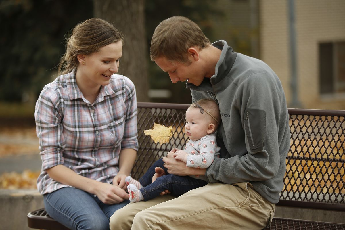 Spencer and Lauren Hanson sit near their home with daughter Lyla in Provo on Nov. 4, 2017. They have been married two years.