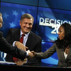 KSL reporter Rich Piatt shakes hands with 4th Congressional District candidates Rep. Jim Matheson and Saratoga Springs Mayor Mia Love after their debate on KSL 5 News in Salt Lake City on Thursday, Sept. 27, 2012. Matheson announced on Tuesday, Dec. 17, 2013, that he will not seek re-election in 2014.