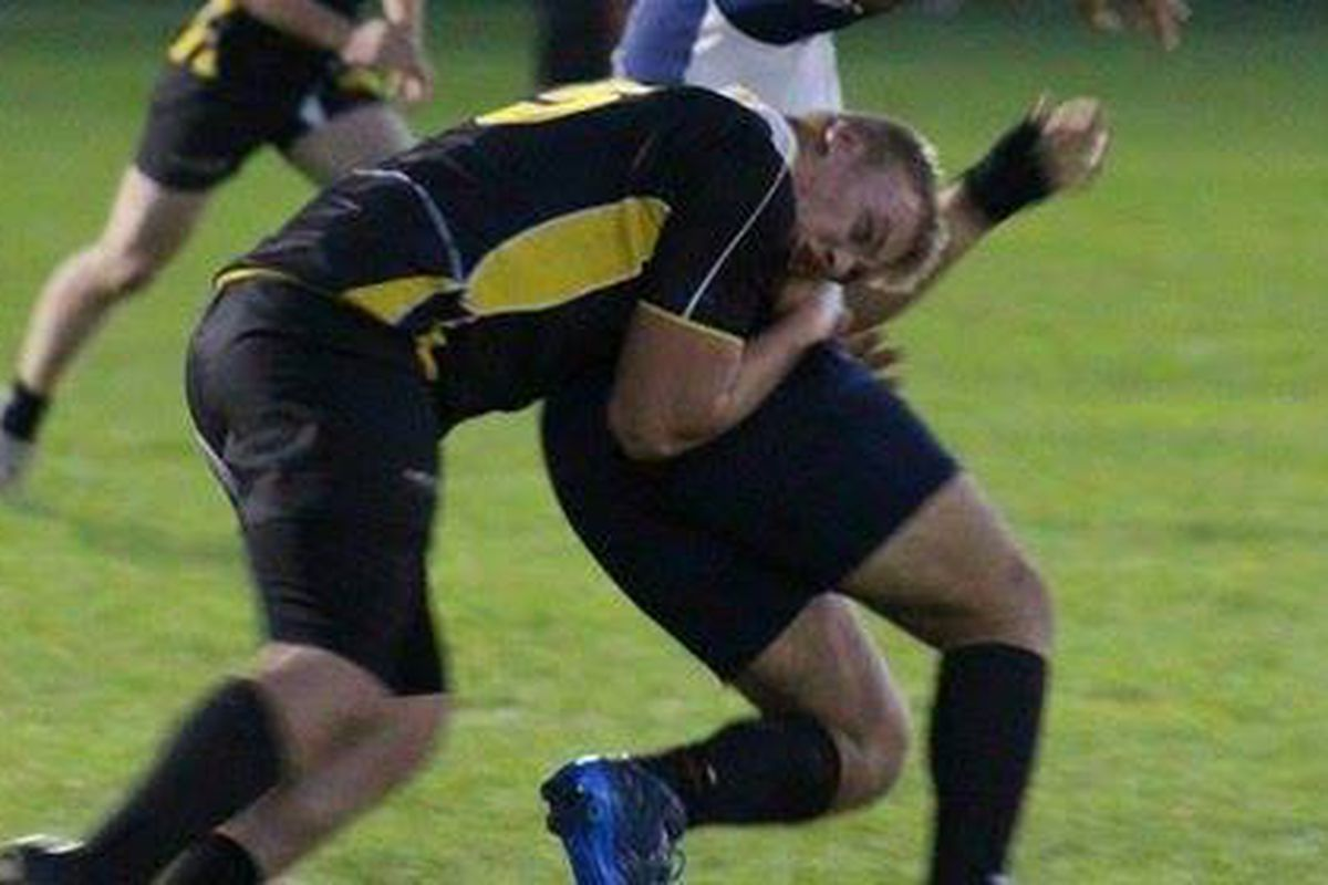 Taylor Vanderlaan making a tackle