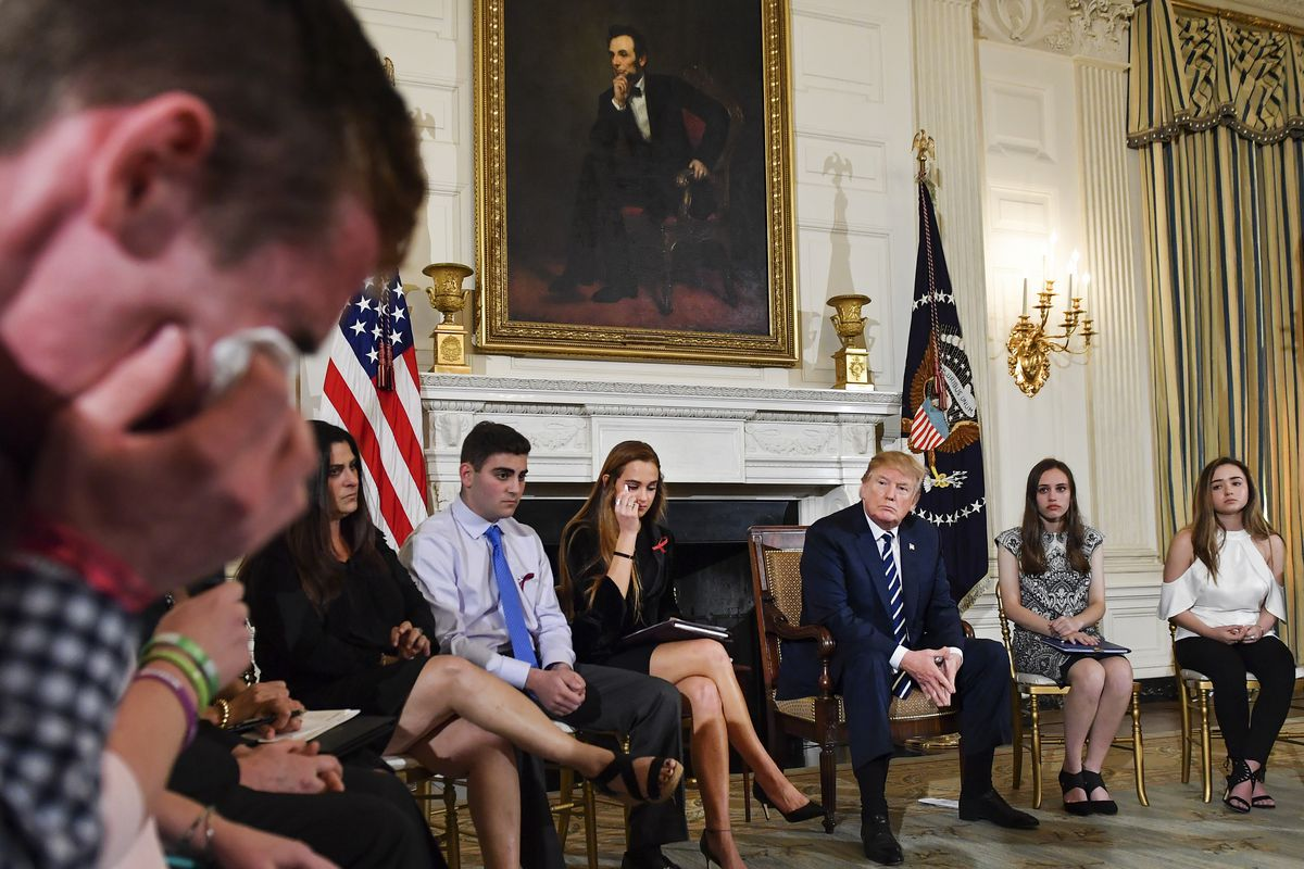 Samuel Zeif, student at Marjory Stoneman Douglas High School, left, weeps after recounting his story of the shooting incident at his high school during President Trump's listening session held at the White House on February 21.