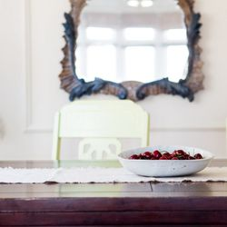 Cherries and a beautiful vintage mirror in the dining room