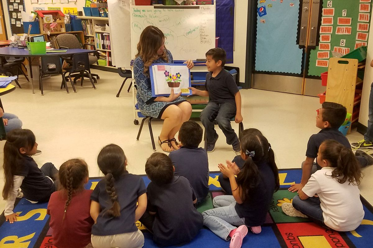 Bilingual teacher Lourdes Sierra reads with her kindergarten students at Vado Elementary School in New Mexico.