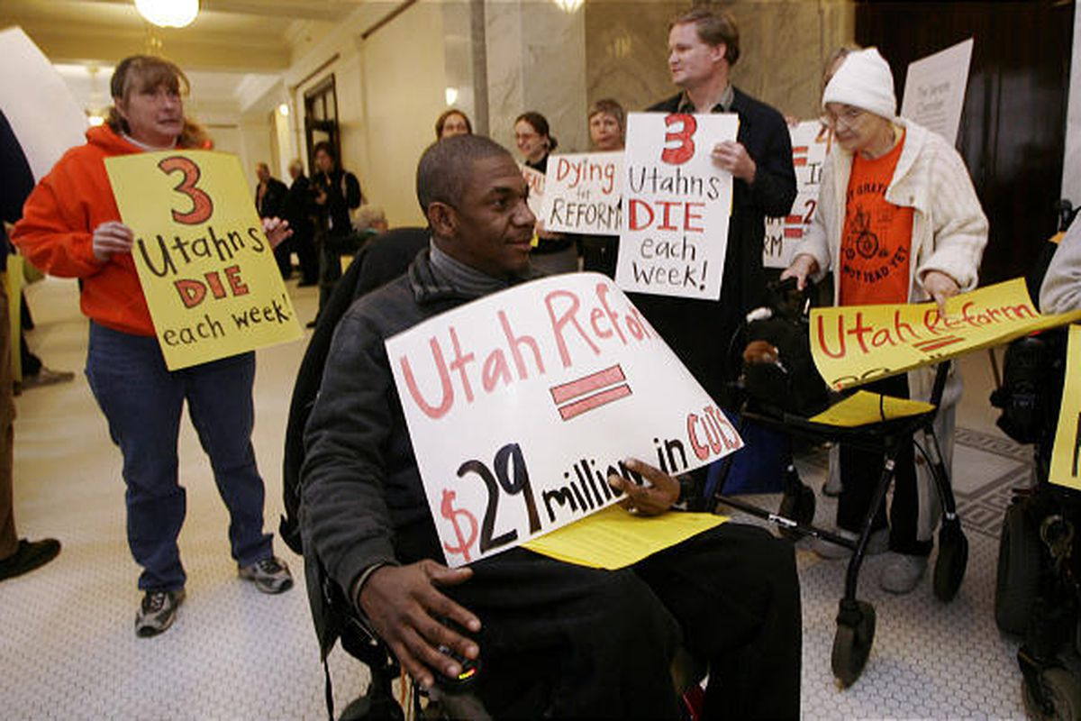 Stevie Edwards, center, and the Disabled Rights Action Committee and the Anti-Hunger Action Committee rally Tuesday.