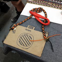 The SFK booth had cardboard cut-outs illustrating how to use their camera straps, which also work for iPhones.