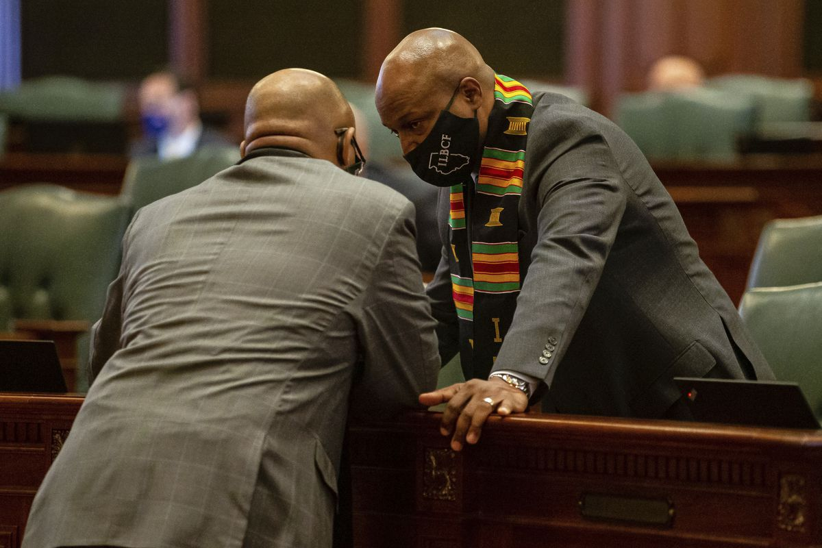 """Illinois Speaker of the House Emanuel """"Chris"""" Welch, D-Hillside, talks with Illinois State Rep. Will Davis, D-Homewood, during session on the floor of the Illinois House."""