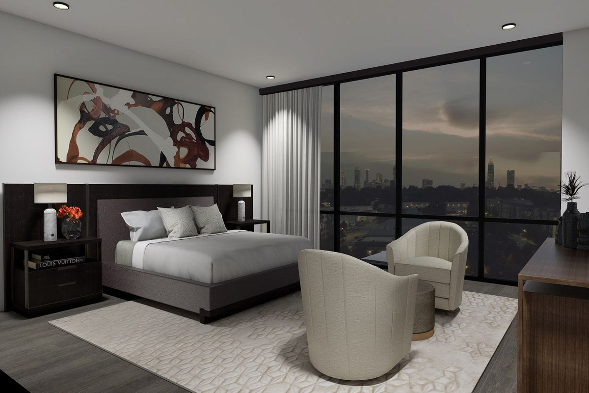 A large white bedroom with city views.