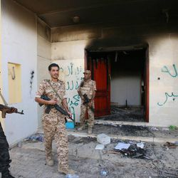 In this Sept. 14, 2012 file photo, Libyan military guards check one of the U.S. Consulate's burnt out buildings during a visit by Libyan President Mohammed el-Megarif, not shown, to the U.S. Consulate to express sympathy for the death of the American ambassador, Chris Stevens and his colleagues in the deadly attack on the Consulate in Benghazi, Libya. Senior State Department officials pressed for changes in the talking points that U.N. Ambassador Susan Rice used after the deadly attack on the U.S. diplomatic mission in Libya last September, expressing concerns that Congress might criticize the Obama administration for ignoring warnings of a growing threat in Benghazi.