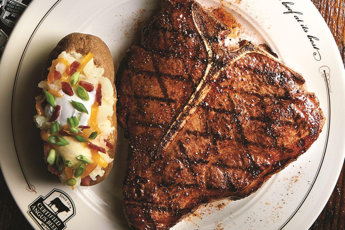 Bone-in rib-eye steak and a loaded baked potato